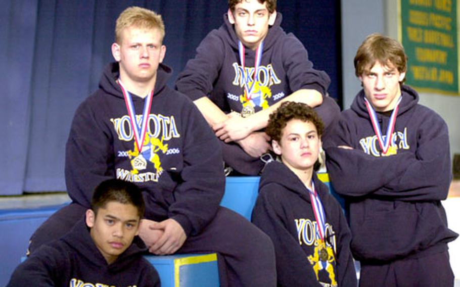 Clockwise from lower left, Patrick Pamintuan, Jim Scott, Jason Rodriguez, Zach Dopslaf and Mark Meade represent the present and future of a Yokota Panthers wrestling program.