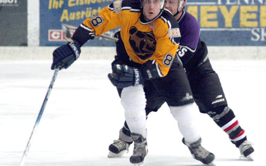 Baden's Remi Johnson is pursued by Bitburg's Terry Courtney during Friday's title game at the 14th Annual USAFE Ice Hockey Championships in Garmisch, Germany. Bitburg won, 4-2.