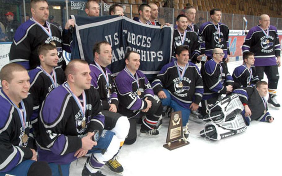 The Bitburg Bears pose with the championship trophy after defeating the Baden Bruins 4-2 on Friday at the 14th Annual USAFE Ice Hockey Championships in Garmisch, Germany.
