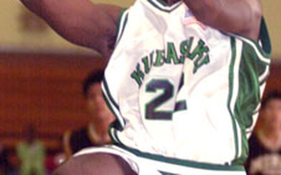 Keith Sturdivant of Kubasaki slices through Mirai Technical defenders to the basket.