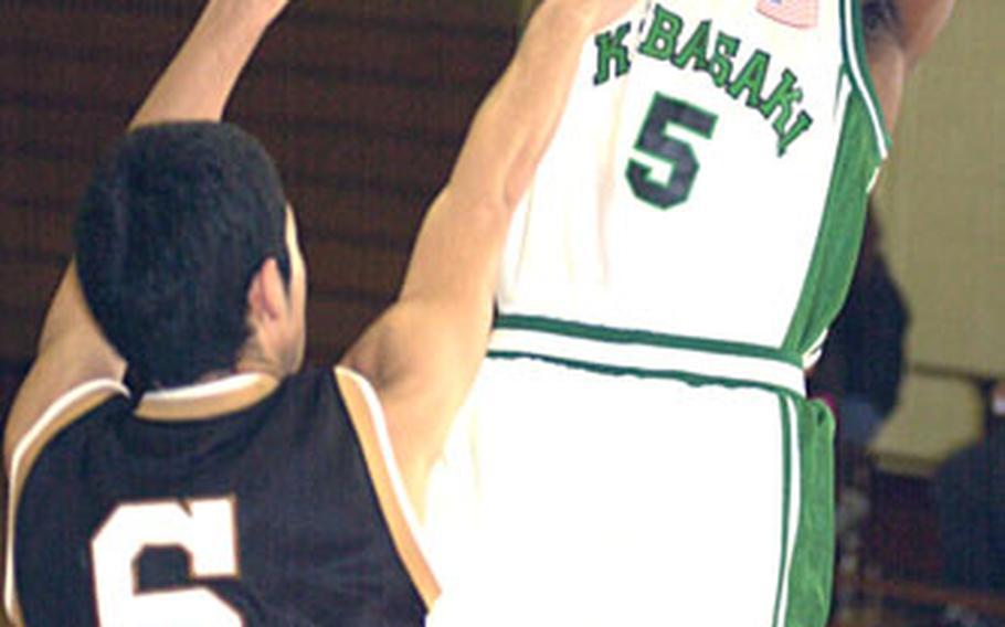 Kubasaki senior Steven Ellis shoots over Mirai Technical defender Shota Noborikawa.