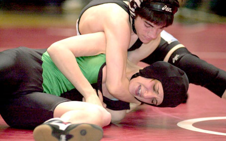 Tyler Perry of Osan American gets the upper hand on Bianca Best of Taegu American during Thursday's 108-pound round-robin bout. Perry pinned Best in 2:54.