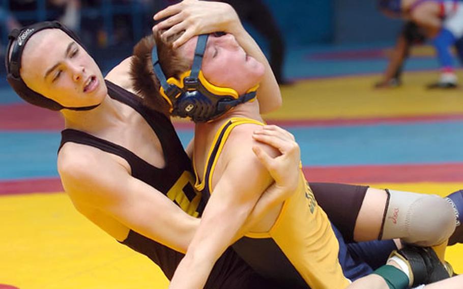 Patch's James Ricks battles Zach West of Heidelberg during a 103-pound quarterfinal match in DODDS' European wrestling championship Wiesbaden, Germany, on Friday. Ricks beat West 13-0.