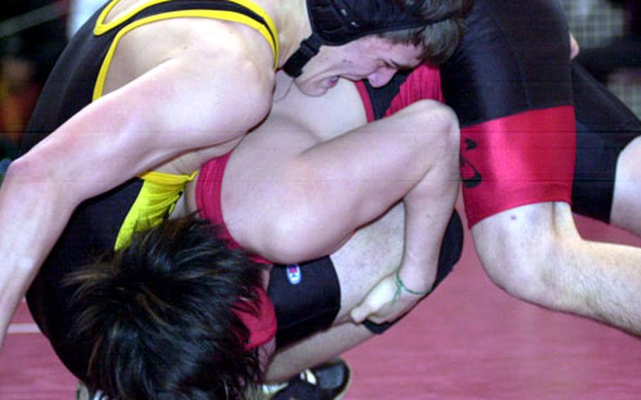Austin Copeland, top, of Kadena battles Yamato Cibulka of Nile C. Kinnick for an advantage during the 148-pound gold-medal bout. Copeland dethroned the defending champion with a 2-1 decision.