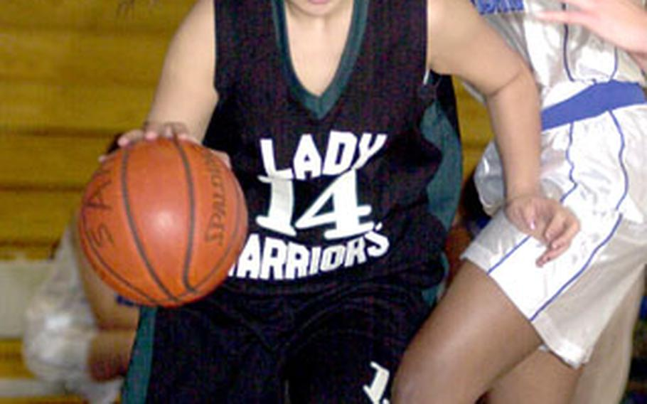 Senior captain Kelli Cox (14) and the Taegu American Warriors are hoping for a homecourt boost when they host the Class A girls tournament next week for the first time.