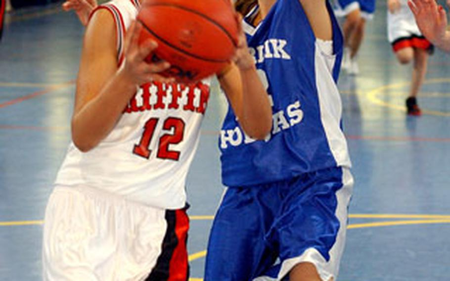Giessen's Elishea Darby,goes to the basket against Incirlik's Melisa Siedow in a Division IV matchup.