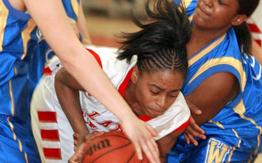 Wiesbaden's Nancy Jensen, left, and Monique Hall tie up Kaiserslautern's Lynndsey Hyter during the first Division I semi-final game at the 2006 DODDS European basketball tournament in Mannheim on Thursday. Kaiserslautern beat Wiesbaden 71-48 to advance to Friday's championship game.