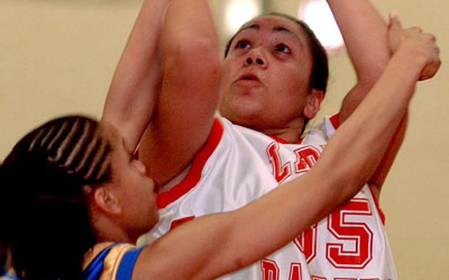 Kaiserslautern's Bianca Gerena-Perez eyes the basket over Wiesbaden's Lakendra Washington.