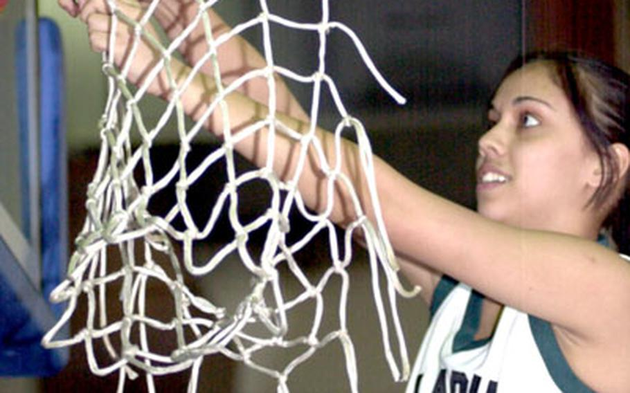 Taegu's Joanne Youngblood cuts down the cords following Friday's championship game.