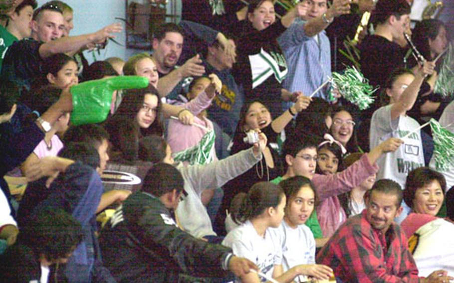 """Taegu American Warriors fans do the """"Tomahawk Chop"""" during Friday's championship game. Taegu rallied from a 25-16 third-quarter deficit to win the first Class A hoops title in school history."""