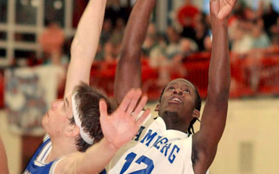 Bamberg's Marvin Gholston shoots over Ansbach's Zach Harmon in the Division III final in Mannheim on Saturday. Bamberg beat Ansbach,71-64.