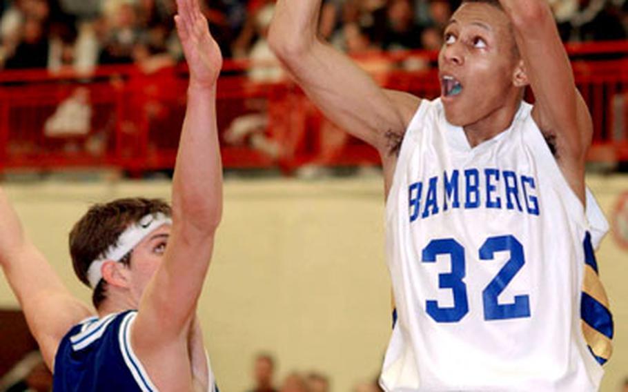Bamberg's Joshua Frank takes a shot over Ansbach's Zach Harmon.