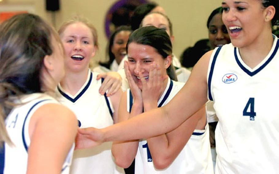 Sigonella players celebrate their victory over Baumholder in the DODDS-Europe girls Division III championship game.