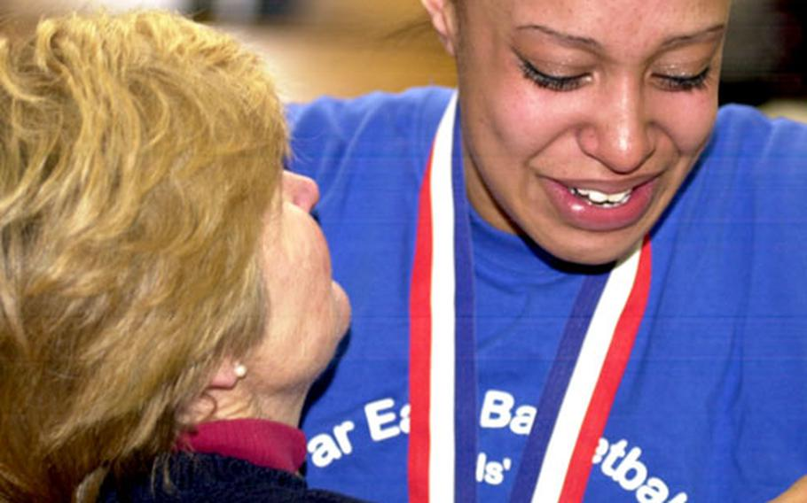 Seoul American senior center Margaret Nurse embraces coach Charlotte Hicks after Saturday's Far East Class AA championship game at Yongsan Garrison, South Korea.