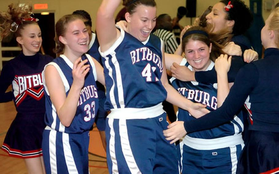 Bitburg celebrates their 45-31 upset victory over top-seeded Hanau in the DODDS Europe Division II girls championship game in Mannheim, Germany, on Saturday night.