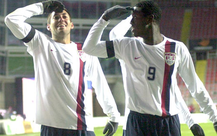Clint Dempsey, left, and teammate Eddie Johnson of the U.S. celebrate Dempsey's game-winning goal against Poland with salutes.