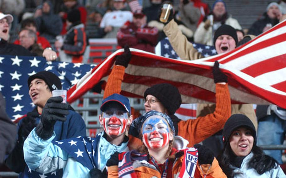 American fans cheer as the U.S. squad takes the field for the second half of their World Cup warmup friendly against Poland in Kaiserslautern, Germany, Wednesday night. 13,395 spectators, many of them Americans servicemembers stationed in Germany, braved freezing temperatures and second-half snow to see the U.S. beat Poland 1-0 on a Clint Dempsey goal.