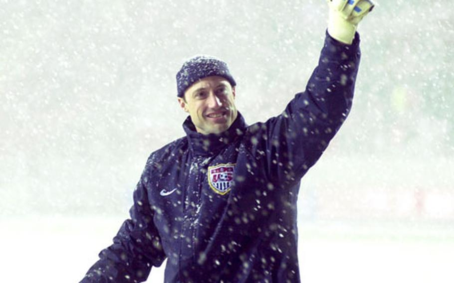 Through the snow, U.S. goalie Kasey Keller gives a thumbs-up to American fans after the game.