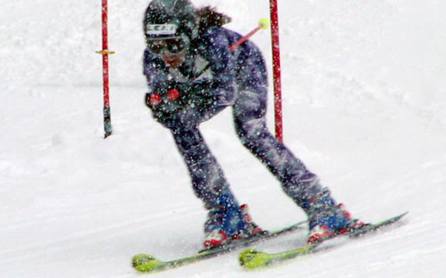 Joyce Ellis, 11, of Garmisch, Germany, masters a snowstorm and the next-to-last gate on the course Saturday during her second run at the U.S. Forces Europe youth giant slalom championship at Garmisch. Ellis, whose older sister Kristin, 15, skied the fastest time of the day -1:26.51 - posted by any skier of any age or sex, clocked a two-run time of 1:31.79 to win the girls' junior event for skiers aged 10-12.
