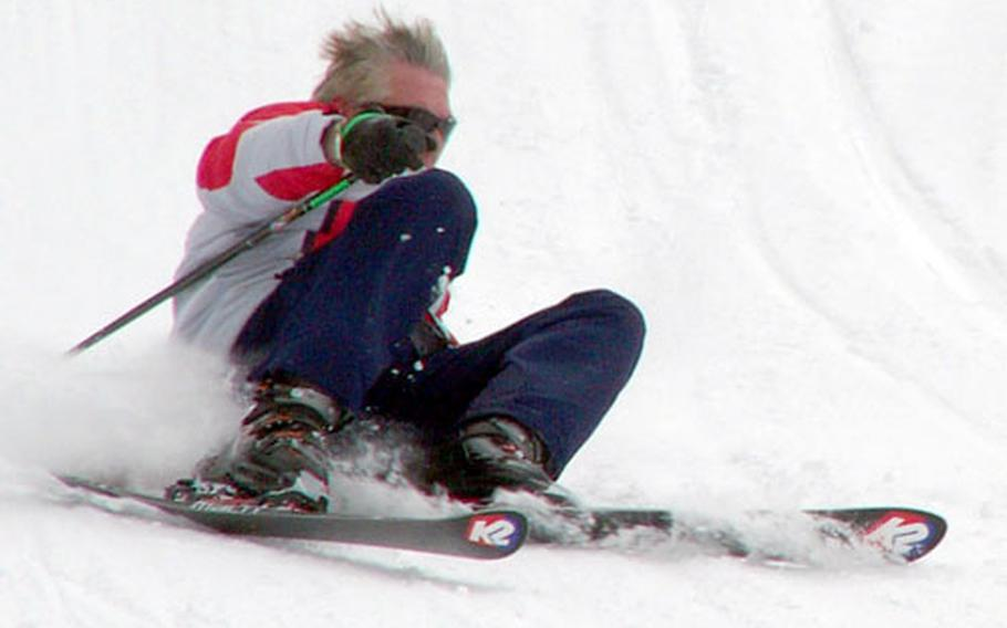Würzburg's James Jannsen, 64, takes a spill just yards from the finish line of the U.S. Forces Europe giant slalom event Saturday at Garmisch.