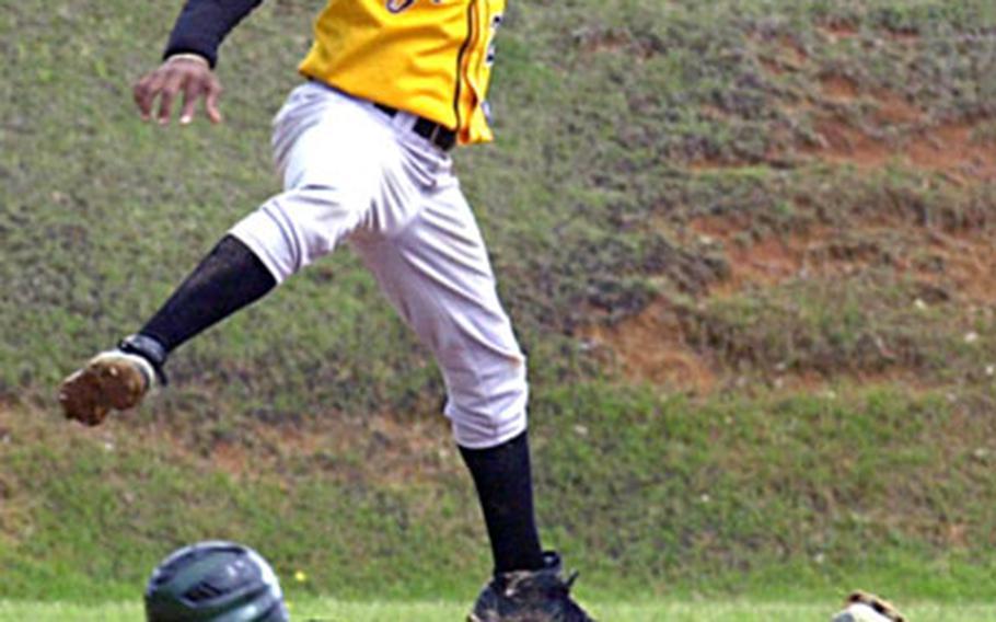 Kubasaki's Michael Fulwiler slides safely into second base as Kadena second baseman Dwayne Gladden leaps over him.