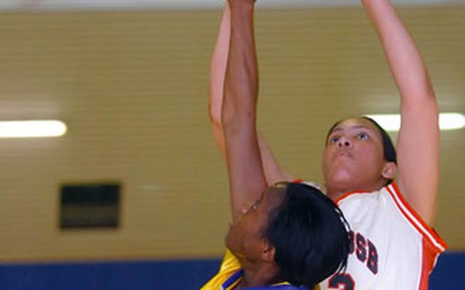 Kitzingen's Bertha Kabuye puts up a shot over Wiesbaden's Lamanda Morant during the finals of the Army Europe Community Level basketball championships in Hanau, Germany, on Sunday.