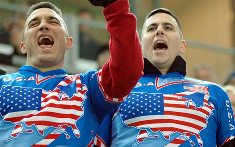 Two U.S. fans show their support for the American squad during Wednesday night's game against Germany in Dortmund.
