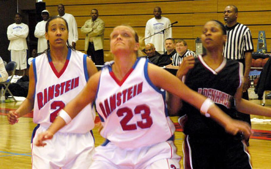 Ramstein's Jennifer Brooks, center, establishes position Friday for one of her 23 rebounds during the Lady Rams' 63-55 USAFE championship-game victory over defending champion Mildenhall on Friday at Spangdahlem, Germany. Flanking Brooks are Ramstein's Ashonda Williams, left, and Mildenhall's Ebony Morris.