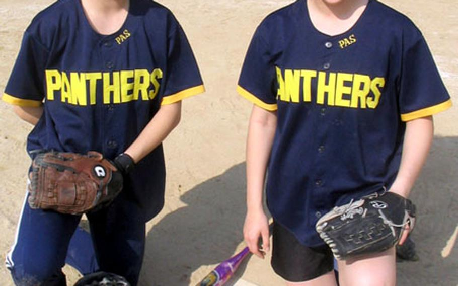 Pusan American senior catcher/pitcher Jeni Smith and her sister, freshman pitcher/catcher Ashley Smith. The Panthers have only eight players, and must borrow a player from their opponents.