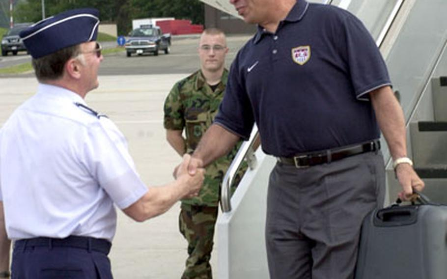 U.S. men's soccer coach Bruce Arena, is greeted by Gen. Tom Hobbins, U.S. Air Forces in Europe commander, Thursday upon landing at Ramstein Air Base.