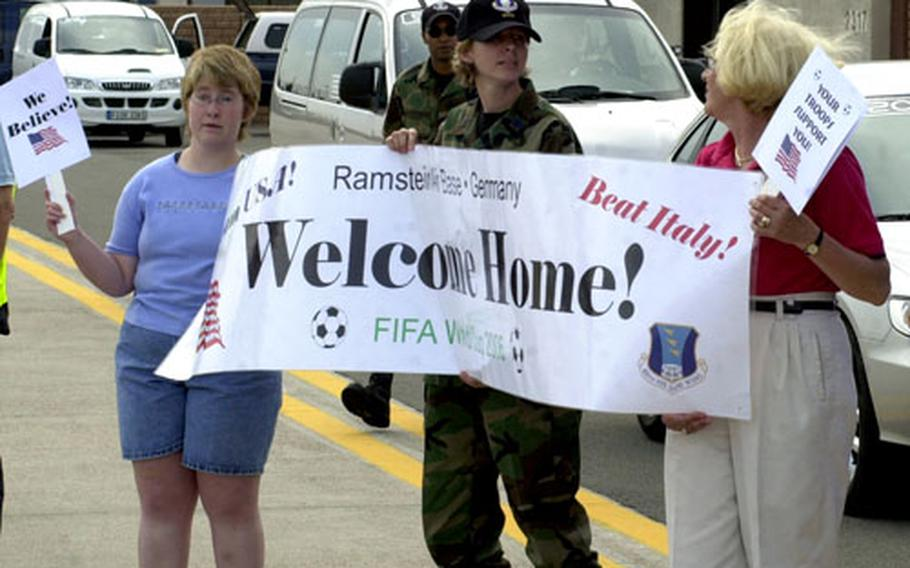 Fans greet the U.S. men's soccer team Thursday evening at Ramstein Air Base, Germany. The American team, which is staying on Ramstein, plays Italy Saturday at 9 p.m. in nearby Kaiserslautern.