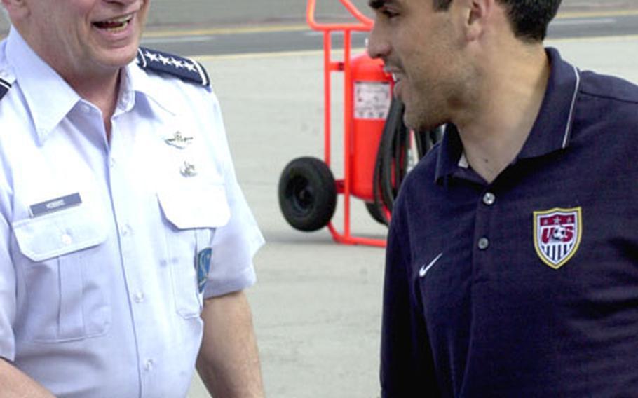 Gen. Tom Hobbins welcomes U.S. men's soccer team captain Claudio Reyna to Ramstein.