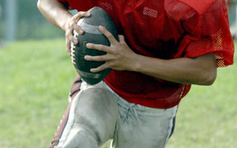 Nile C. Kinnick quarterback Jeff Galang runs the option during Monday's practice at Briggs Bay athletic complex, Yokosuka Naval Base, Japan.