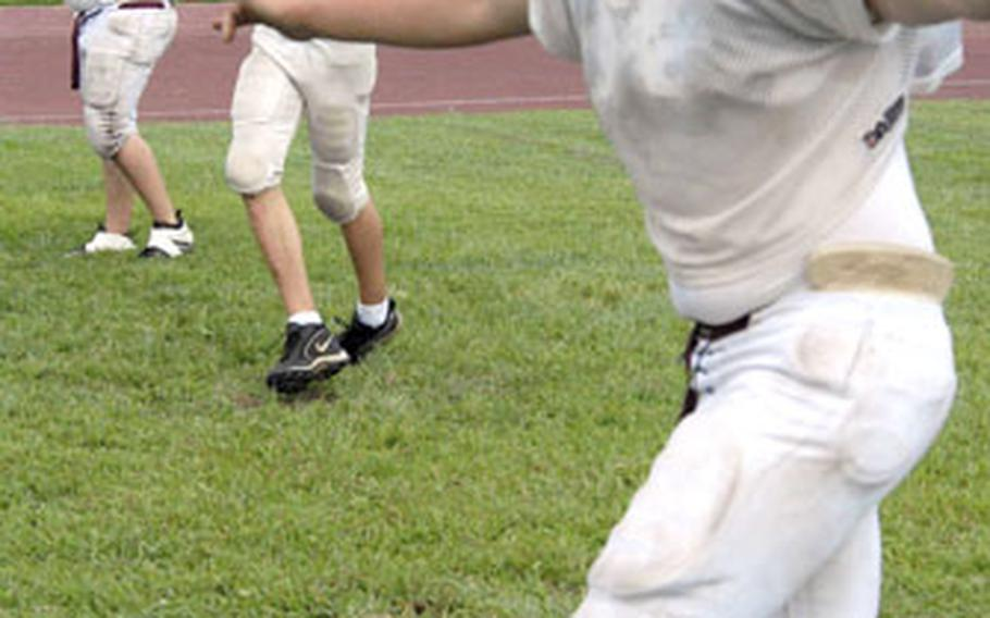 Zama American Trojans football players engage in agility drills during Tuesda''s practice at Zama American High School, Camp Zama, Japan.