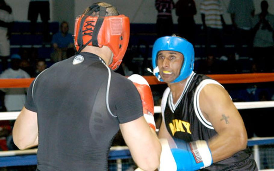 Staff Sgt. Geremy Ganaway, right, readies a punch at 2nd Lt. John Rigsbee during the Tough Soldier Boxing Invitational.