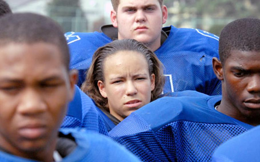 """Just one of the guys: Yokota linemate Corey Reich says Samantha Little is a welcome addition to the Panthers football team. """"She hits hard,"""" Reich says. """"She gives it everything she's got."""""""