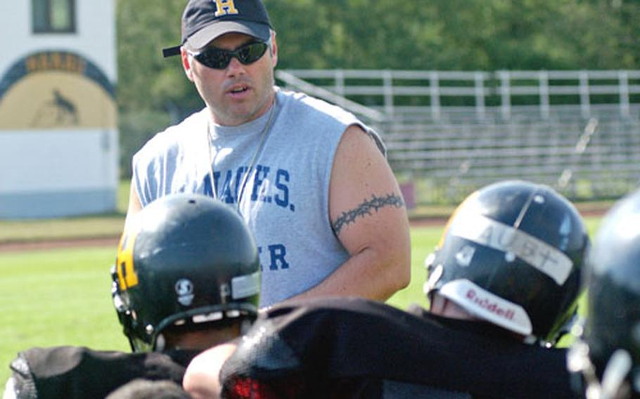 Hanau High School football coach Sam Cassou talks to his team during practice. Defending DODDS-Europe Division II champ Hanau is competing in Division III this year, due to a drop in the size of the school's student body.