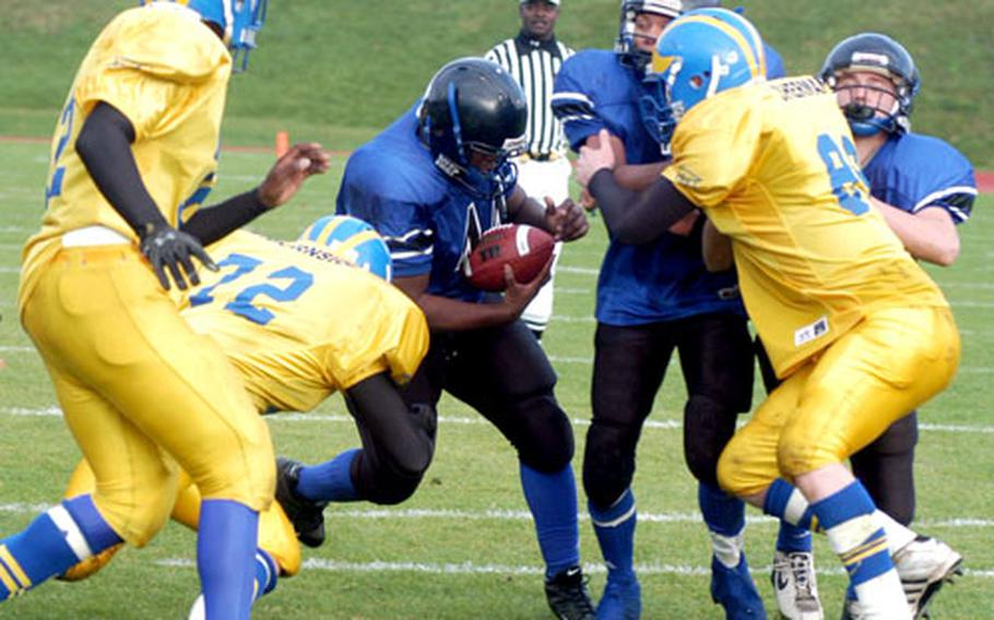 Hohenfels' Brandon Merriweather carries the ball in last season's Division III championship game against Ansbach. Merriweather is one of three returning All-Europe selections for the defending D-III champions.