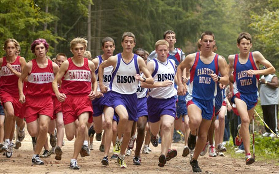 Ramstein runners Kyle Southard and Kevin Edwards, far right, lead the charge off the starting line during the first cross country race of the season held in Vogelweh, Germany, on Saturday.