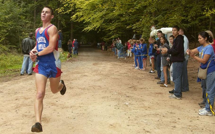 Ramstein senior Kyle Southard approaches finish line during a cross country race in Vogelweh, Germany, on Saturday. Southard finished first, covering 5 kilometers in 16 minutes, 43 seconds.