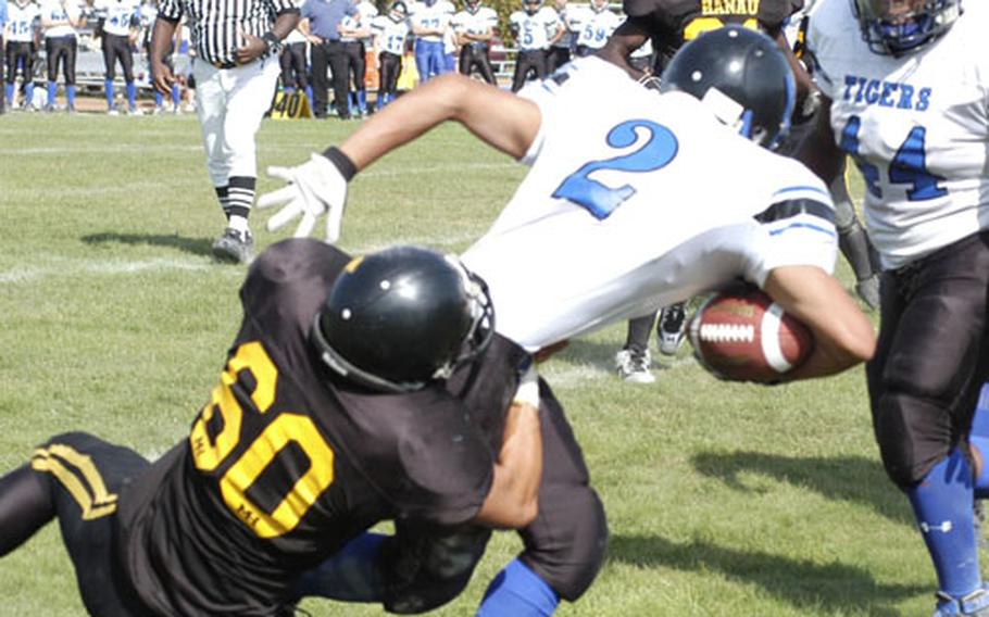 Hohenfels' Nate Apodaca struggles to stay up against Hanau's Jerrell Banks in the third quarter of the Tigers' 31-6 loss to the former Division II champs on Saturday.