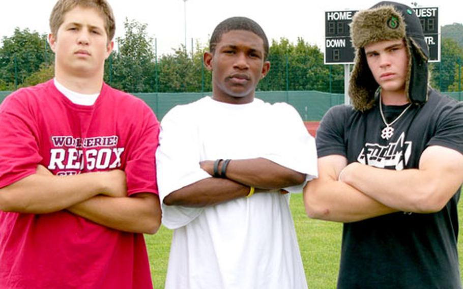 Würzburg High School tailback D.B. Bryant is flanked by guards Dan Riley, left, and Sean Hipe, who helped spring him for 437 rushing yards on 32 carries Saturday in an 80-48 victory over Vicenza.
