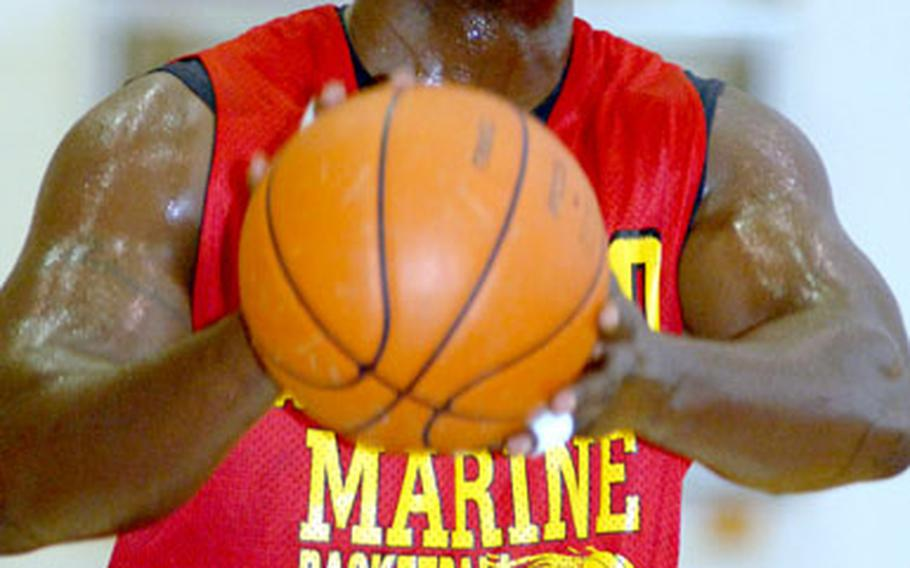 Tony Ellis of 3rd Marine Logistics Group puts up a foul shot against Navy during Wednesday's Joint Military Athletic Conference basketball game at Kadena Air Base, Okinawa. 3rd MLG won 83-55.