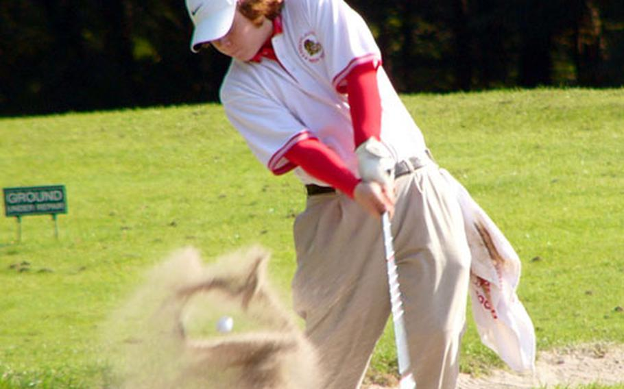 Kyle Bookout of Kaiserslautern exits a bunker on Rheinblick Golf Course's eighth hole Thursday during first-day play in the two-day DODDS-Europe high school golf championships, which end Friday at Wiesbaden-Frauenstein.