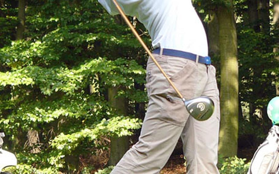 Barbara Burriss of Kaiserslautern follows through on her tee shot on Rheinblick Golf Course's sixth hole Thursday.