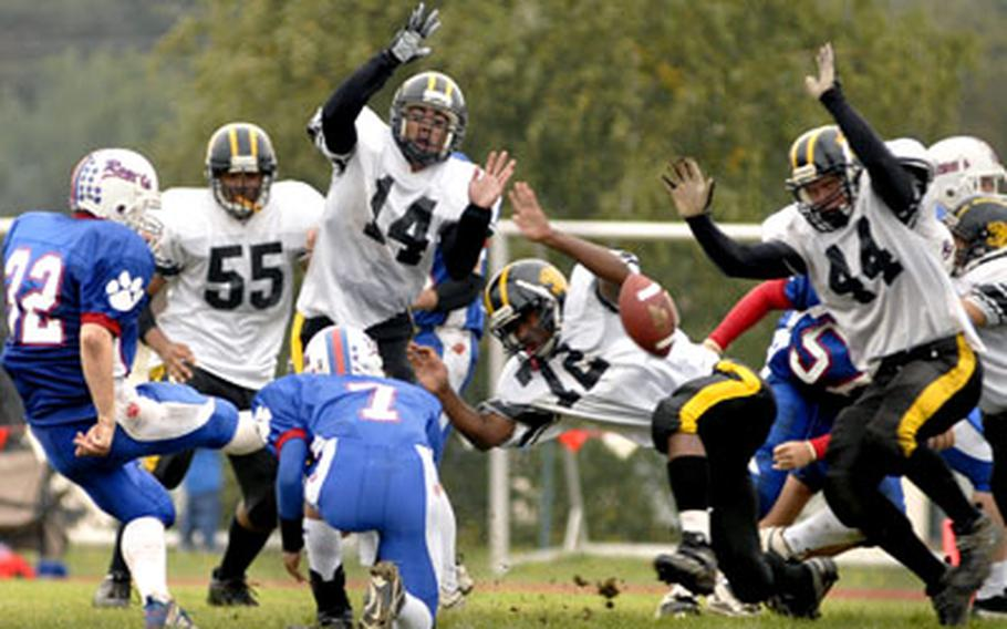 The Patch defense blocks an extra point attempt by Joel Smith during the second half of Patch's game against Ramstein on Saturday.