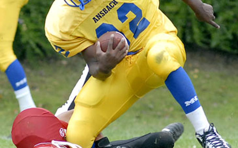 Ansbach's Xavier Sheppard gets pulled down by Giessen's Tim Fleming during Ansbach's 39-0 victory on Saturday.  for more photos from Giessen's final homecoming.