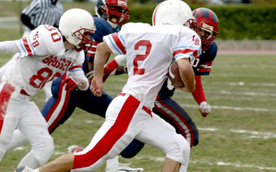 ISB junior running back Philip Feldman heads toward the right sideline Saturday during the Raiders' 20-6 victory over Aviano in Italy. Feldman rushed 11 times for 64 yards in the first half as his team built a 20-0 advantage.