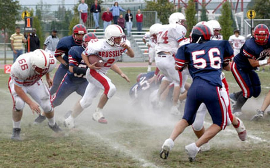 ISB junior running back Philip Freedman heads up field in a cloud of chalk Saturday during the Raiders' 20-6 victory over Aviano in the regular-season finale for both teams.