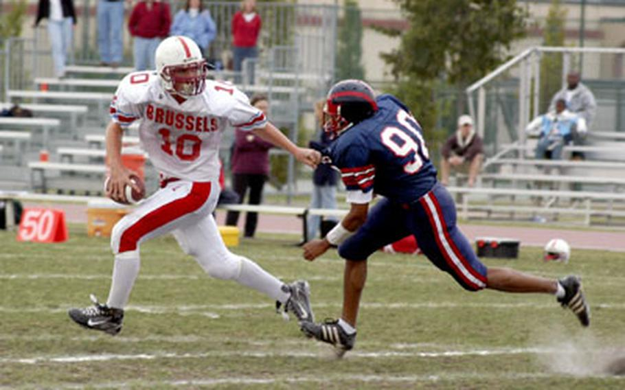 ISB quarterback Raphael Steege eludes Aviano's Dante Rankin while trying to find time to complete a pass Saturday in Aviano, Italy.